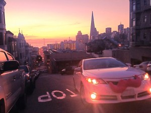 A Lyft car cruises through San Fransisco. The service is now available in Pittsburgh.