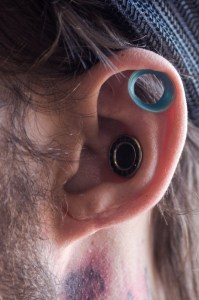 (Aaron Warnick / Photo Editor)- Helix tunnels in the ear of Twitch