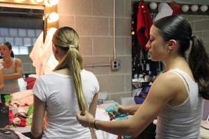 (Claire Murray / Photo Editor) - Junior Katy Nemeth braids fake hair into the hair of freshman Anastasiya Kaspruk.