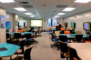 Photo by Taylor Miles | The Duquesne Duke. 442 Fisher Hall, a FlexTech classroom, features collaborative work stations.