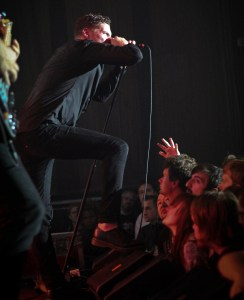 Courtesy of Nick Seyler- Vocalist George Clarke of black metal band Deafheaven screams on stage last Thursday at the Rex Theater.