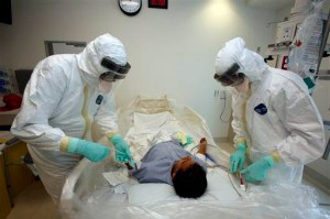 AP Photo. Doctors participate in an exercise on diagnosing and treating patients with Ebola virus symptoms at the Ronald Reagan UCLA Medical Center in Los Angeles.