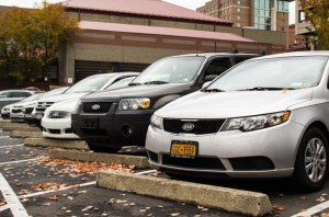 Photo by Claire Murray | Photo Editor. Cars sit parked in the lot between the Palumbo Center and Forbes Garage.