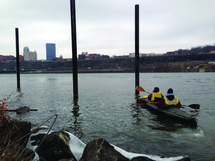 Photo by Julian Routh | News Editor. The search for missing Duquesne graduate Paul Kochu took to the river last Thursday as volunteers kayaked the Monongahela River in pursuit of any clues of Kochu's whereabouts. Volunteers also used a boat to search the embankment.
