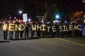 """Photo by Claire Murray   Photo Editor. Marchers at a protest in Pittsburgh on Monday carry letters spelling out """"#EndWhiteSilence,"""" a popular Twitter hashtag promoting racial justice in America."""