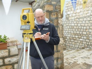 Courtesy Photo. Dean Philip Reeder collects survey data using a Total Station at the Greek Orthodox Bishop of Nazareth's residence near Mary's Cave.