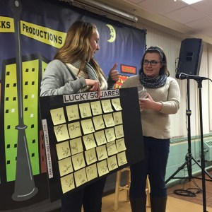 (Addie Smith / Opinions Editor) McKenzie Clarke and Addison Smith call out numbers for a raffle at the Funny Fundraiser.