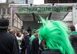 "Photo by Claire Murray | Photo Editor. Someone celebrates St. Patrick's Day by donning a green wig and attending an ""Irish Fair in the Square"" concert in Market Square after the parade ended."