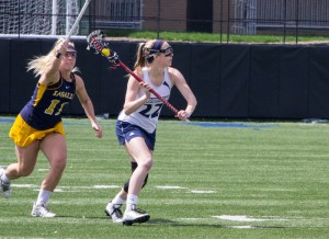 Natalie Fiorilli / The Duquesne Duke Freshman Shae Cowley looks for a teammate in the offensive zone during Sunday's 10-8 win over La Salle. The Dukes return to action on Friday against George Washington at 4 p.m.