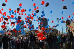 Joseph Guzy / The Duquesne Duke The Duquesne community celebrates the lives of the late Ryan Fleming and Chris Johnson with a moment of silence and a balloon release ceremony at halftime.
