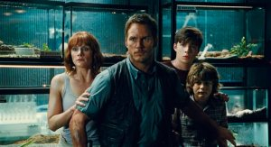 "AP Photo. Bryce Dallas Howard, from left, as Claire, Chris Pratt as Owen, Nick Robinson as Zach, and Ty Simpkins as Gray, in a scene from the film, ""Jurassic World."""