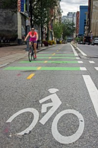(Claire Murray/Photo Editor) A cyclist rides on the Penn Avenue bike lane. Bike counting sensors have been placed at three different spots throughout Penn Avenue to monitor bicycle traffic along the route.