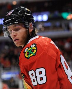 Chicago Blackhawks right wing Patrick Kane (88) warms up before a pre-season NHL hockey game against the Detroit Red Wings in Chicago, Tuesday, Sept. 22, 2015.  (AP Photo/David Banks)