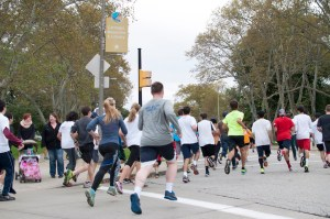 Courtesy of Pittsburgh Donut Run. A swarm of runners take part in last Sunday's Donut Dash. On top of this physical activity, participants also had to consume donuts mid-race. Proceeds benefit the Live Like Lou Center for ALS Research.