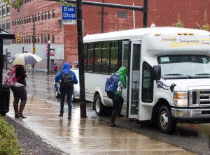 "Claire Murray | Photo Editor A commuter student boards the South Side Shuttle. Duquesne President Dougherty's recent comments about ""libertine"" commuters led to criticisms from parents."