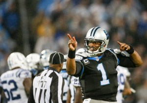AP Photo Carolina Panther's quarterback Cam Newton celebrates during a 2015-16 matchup with the Indianapolis Colts.