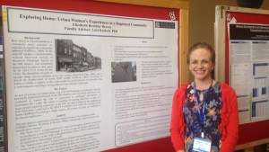 Kayla Casavant | The Duquesne Duke Graduate psychology student Elizabeth Brown stands next to a poster that explains her research project at the 2015-16 Graduate Research Symposium.
