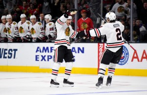 FILE - In this Nov. 28, 2015, file photo, Chicago Blackhawks right wing Patrick Kane, left, celebrates his goal with defenseman Duncan Keith during the first half of an NHL hockey game against the Los Angeles Kings in Los Angeles. Kane's second-period goal against Minnesota on Tuesday, Dec. 1, extended his point streak to 20 games, one shy of the franchise record set by Hall of Famer Bobby Hull during the 1971-72 season. (AP Photo/Mark J. Terrill, File)