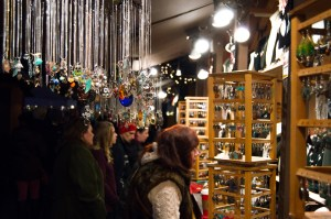 By Joseph Guzy | The Duquesne Duke Holiday shoppers visit the Christmas market in Market Square.