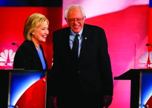Democratic presidential candidates Hillary Clinton and Sen. Bernie Sanders speak during a break at the NBC, YouTube Democratic presidential debate on Jan. 17. In order for Clinton to beat Sanders, she will need to evaluate what went wrong with her campaign in 2008.