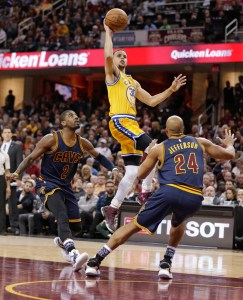 AP Photo - Golden State Warriors' Stephen Curry (30) shoots over Cleveland Cavaliers' Kyrie Irving (2) and Richard Jefferson (24) in the first half of an NBA basketball game Monday, Jan. 18, 2016, in Cleveland.