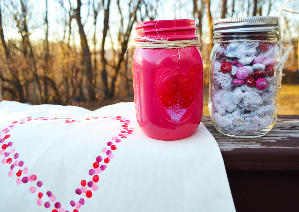 Photo by Rebekah Devorak | Opinions Editor. The finished products (from left to right): painted heart tote bag, mason jar candle and mason jar filled with puppy chow.