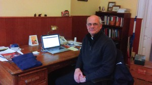 Gigi Jeddi   The Duquesne Duke Rev. Dan Walsh, a Spiritan priest at Duquesne, poses for a picture at his desk in Old Main. Walsh is one of several Spiritans recording his life story for posterity.