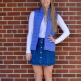 Photo by Gabriella Vaccaro | The Duquesne Duke. This outfit pairs a blue J. Crew vest with a simple white shirt to create a layered look. The Brandy Melville at PacSun skirt brings the spring feel to the outfit. Rain boots are essential for spring showers, and simple Converse work well for dry days.