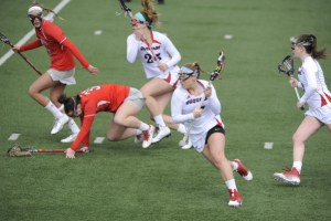 Courtesy of the Athletic Department - Senior attack Lib Lowry carries the ball upfield during a 2015 match last spring. Lowry is currently enrolled in Duquesne's Education School and has been student teaching when not on the pitch.