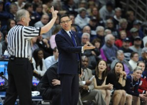 Courtesy of Athletic Department - Women's basketball head coach Dan Burt argues a call made during the Dukes' matchup with the UConn Huskies in the second round of the 2016 NCAA Women's Basketball Tournament. This winter, Burt will return for his fourth year as the team's bench boss.