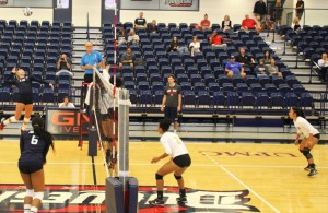 Sophomore outside hitter Maddie Bazelak crushes a spike against Coppin State in the 3-0 win.