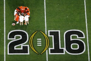 FILE - In this Jan. 11, 2016, file photo, Clemson players huddle before the NCAA college football playoff championship game against Alabama, in Glendale, Ariz. Alabama is No. 1 in The Associated Press preseason Top 25. Clemson is No. 2. (AP Photo/Ross D. Franklin, File)