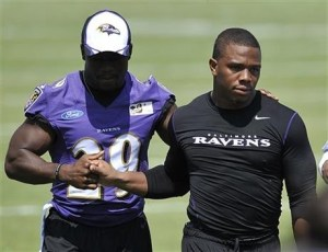AP Photo Rice, right, walks off the field before addressing media at a news conference.