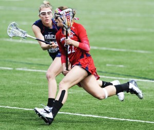 Courtesy of Duquesne Athletics Caitlin Prince goes toward goal in her senior season against Robert Morris. Just over two years later, Prince is back on the Bluff for a second stint — this time as the assistant coach under Evans.