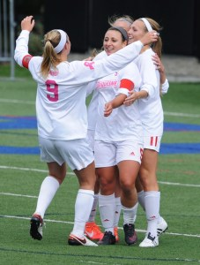 Senior midfielder Maddie Layman, junior forward Linnea Faccenda and freshman forward Katie O'Connor celebrate a goal in their 2-0 win over Davidson on Oct. 9 at Rooney Field in Pittsburgh.