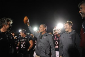 Courtesy of Duquesne Athletics Duquesne head football coach Jerry Schmitt holds up the game ball after securing the 100th win of his career 31-24 over Robert Morris.
