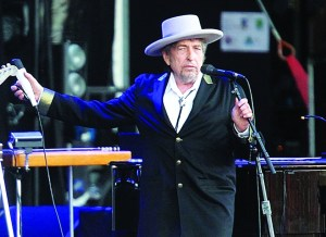 """AP Photo FILE - This July 22, 2012, file photo shows U.S. singer-songwriter Bob Dylan performing onstage at """"Les Vieilles Charrues"""" Festival in Carhaix, western France. Dylan won the 2016 Nobel Prize in literature, announced Thursday, Oct. 13, 2016. (AP Photo/David Vincent, File)"""