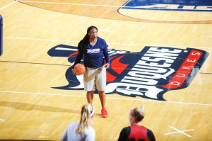 Courtesy of Duquesne Athletics Assistant coach Cherie Lea runs a drill at practice before the start of the 2016-17 Duquesne women's basketball season. Lea returns to the Bluff after coaching at NCAA Division II Wingate University.
