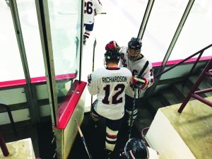 David Borne | Staff Writer Senior captain Zak Kindya gets ready to take the ice with fellow senior Derek Richardson before their game against the University of Pittsburgh at Alpha Ice Complex on Jan. 20. The Dukes won 4-2.