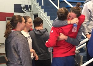 Kaye Burnet  Editor-in-ChiefTwo Duquesne swimmers embrace after a press conference Jan 10, five days after the Fort Lauderdale airport shooting.