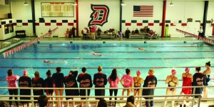 Courtesy of Duquesne Athletics | The Duquesne swim team looks on as its teammates compete in a dual meet. Duquesne has added diving to complement its swim program.