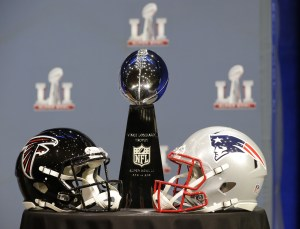 The Vince Lombardi Trophy is seen before NFL Commissioner Roger Goodell's news conference during preparations for the NFL Super Bowl 51 football game Wednesday, Feb. 1, 2017, in Houston. (AP Photo/David J. Phillip)