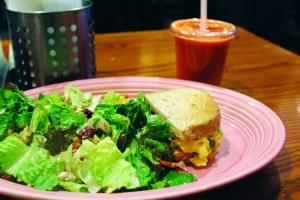 "Nina Saluga | Staff Writer A fruit and nut salad and mesquite turkey sandwich with a ""Sunrise Suzy"" from Red Oak Cafe."