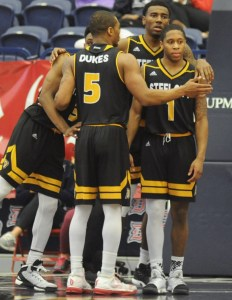 Courtesy of Duquesne Athletics | Mike Lewis II (front right), Isiaha Mike (back right), Emile Blackman Jr. (front center) and Tarin Smith (back left) huddle up and look on in disappointment as they watched a double-digit lead slip away against SJU.