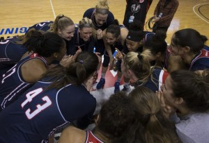 Courtesy of Duquesne Athletics   The Dukes huddle up at center court in the Richmond Coliseum as they took on the Saint Joseph's Hawks in the Atlantic 10 semifinals. The Dukes defeated the Hawks 78-63 on March 4 to advance to the tournament final.