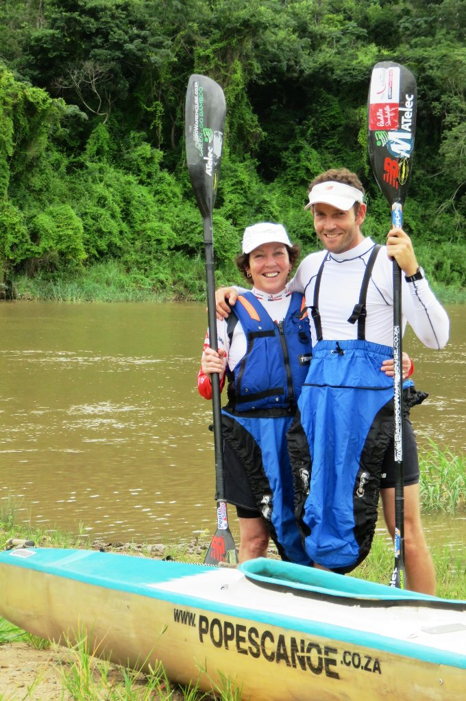 Pope's Canoe Centre/Matelec ace Ant Stott (right) faces a different set of Dusi Canoe Marathon pressures this time around as the progress of he and his 63 year-old mom, Beth (left), are scrutinized closely by the rest of the Stott clan. Image: Supplied / Gameplan Media