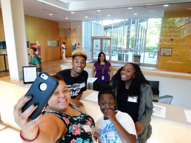 "A group of Eagle Connect students take a ""selfie"" photo inside the Wynn Center."
