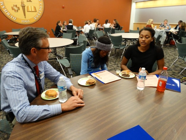 Dr. Mitchell Heflin speaks with two students during the Duke Geriatric Education Center Dementia Roundtable on Wednesday.