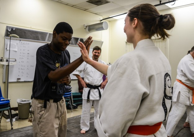Kalif Ruebin learns one of 17 techniques of self-defense during Aikido practice