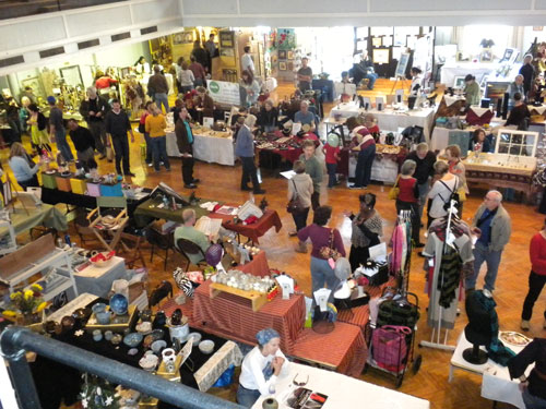 Artists displaying their wares in the Armory during Art Walk